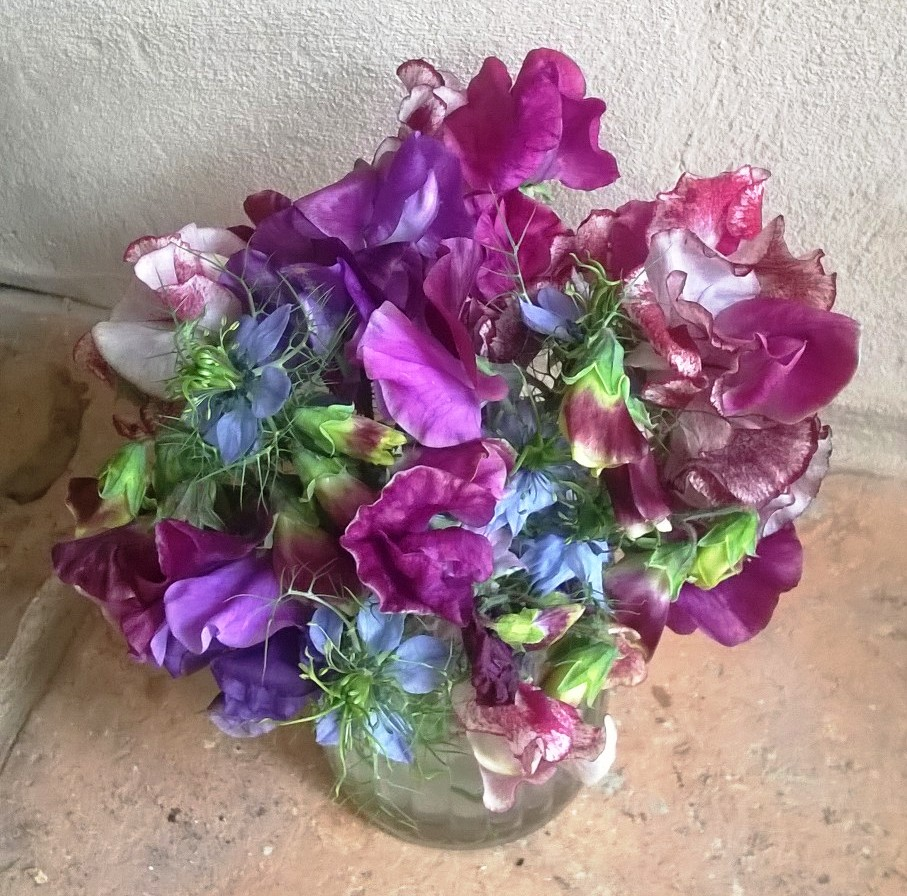 Nigella arranged with Sweetpeas