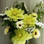 Dahlias with feverfew, statice and marigolds